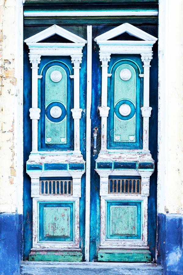 Old blue ornate front of the door with stucco molding stock images