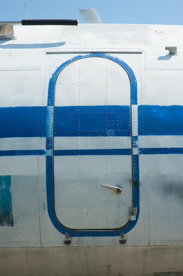 Old blue painted aircraft door close up.  royalty free stock photos