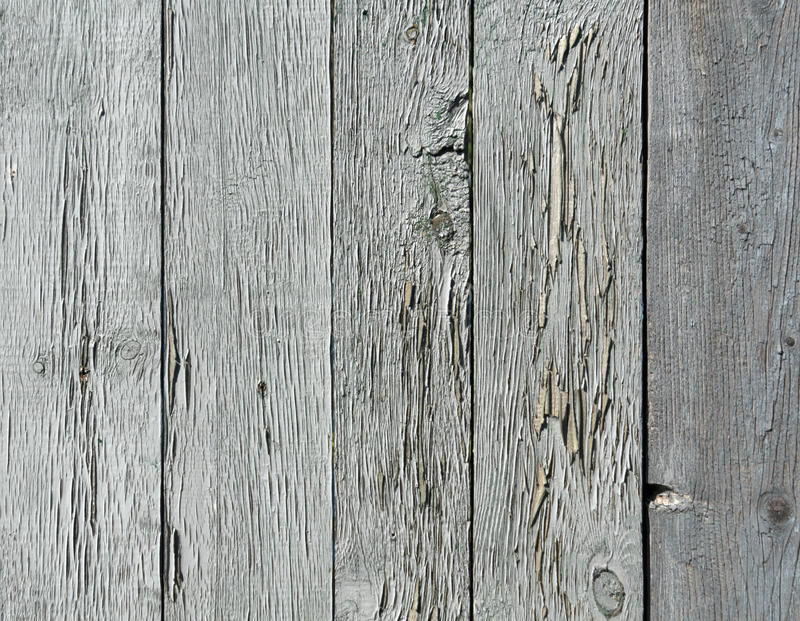 Old blue painted fence from chipboard. Architectural background stock image