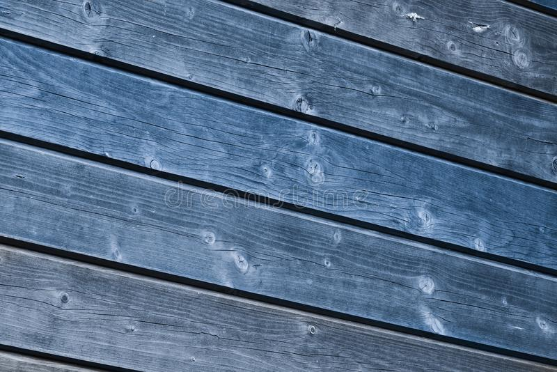 Old blue painted wood wall - texture or background. Natural photo royalty free stock photo