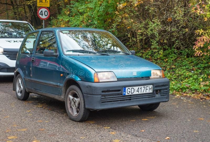 Old blue Polish small Fiat Cinquecento parked. Smart, nice, old and formerly very popular but nowadays rare Polish little car Fiat Cinquecento in Gdansk Oliwa royalty free stock photos