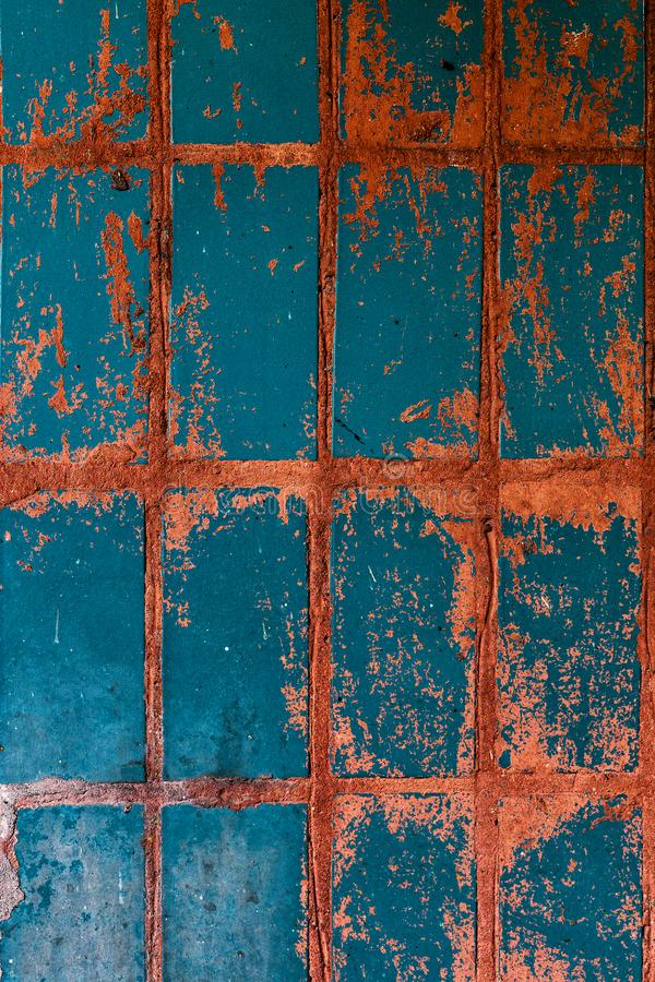 Old blue-red tile on the wall, rustic background. Old blue-red tile on wall, rustic background, floor, illustration, home, vintage, square, tiled, decor, white royalty free stock image