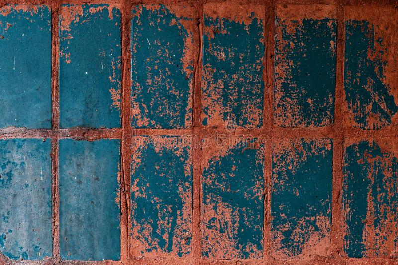 Old blue-red tile on the wall, rustic background. Old blue-red tile on wall, rustic background, floor, illustration, home, vintage, square, tiled, decor, white royalty free stock photos