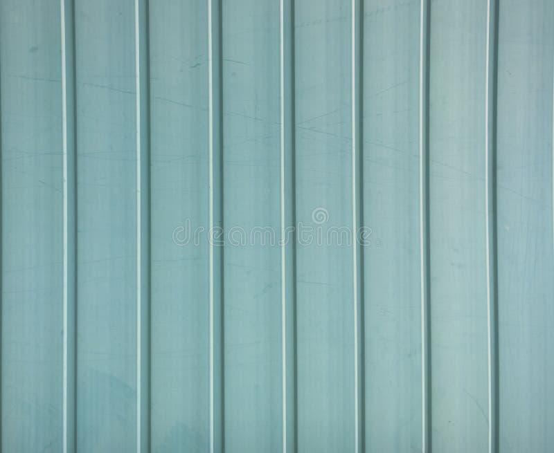 Old blue siding texture. Vintage panel background stock photos