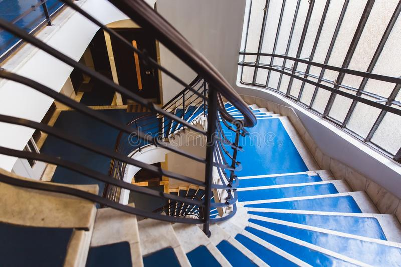 Old blue spiral staircase, spiral stairway inside an old house in Budapest, Hungary. Project Budapest 100. Old blue spiral staircase, spiral stairway inside an royalty free stock photos