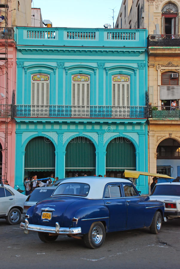 Free Old Blue Vintage Cuban Plymouth Classic Yank Tank Car In Front Of Colourful Building In Havana, Cuba Royalty Free Stock Photography - 40327387