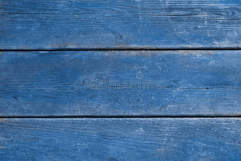 Old blue weathered wood background. Antique weathered wood with scraped blue paint, background, copy space stock images