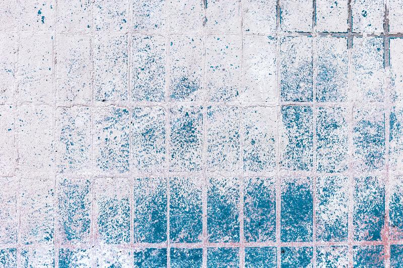 Old blue-white tile on the wall, rustic background. Old blue-white tile on wall, rustic background, floor, illustration, home, vintage, square, tiled, decor stock photography