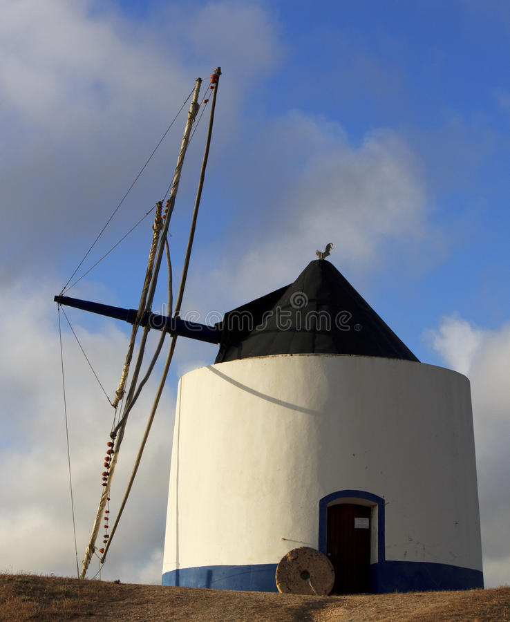 Old blue and white windmill royalty free stock photography