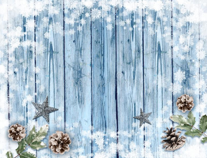 Old blue wood holiday background with snow frame and decorations royalty free stock photos