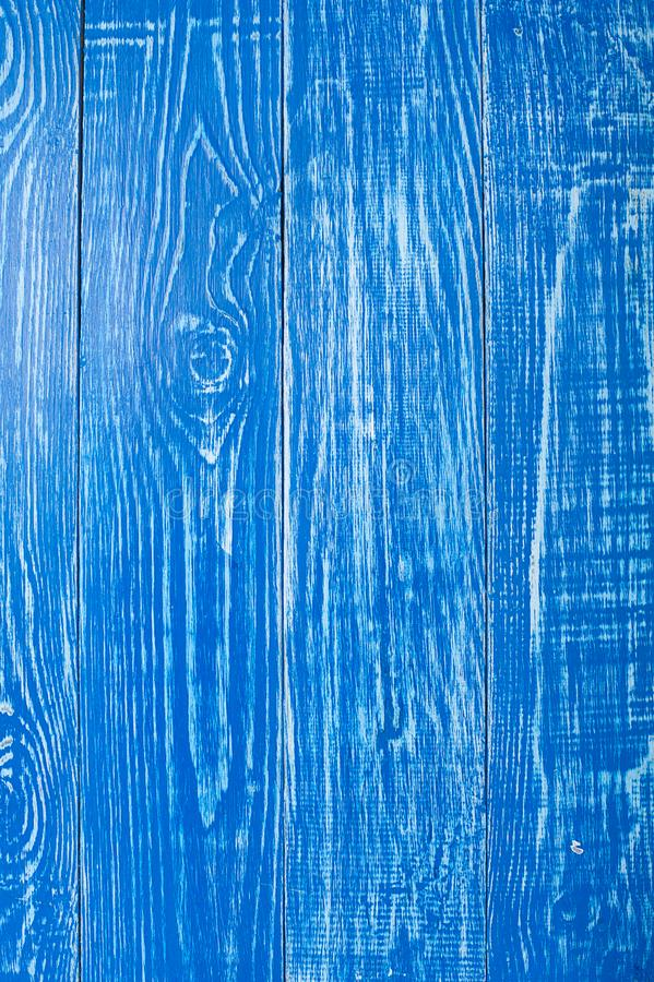 The old blue wood texture with natural patterns. Backgrounds concept - old wooden fence painted in blue background. The old blue wood texture with natural stock image