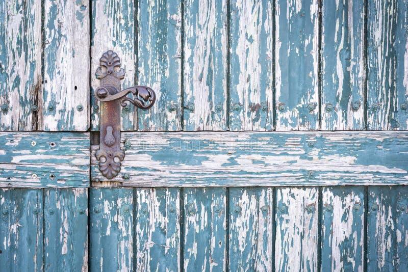 Old blue wooden door with old door handle. As background stock photo