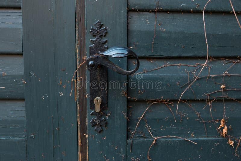 Old blue wooden doors with vintage black door handle stock photography