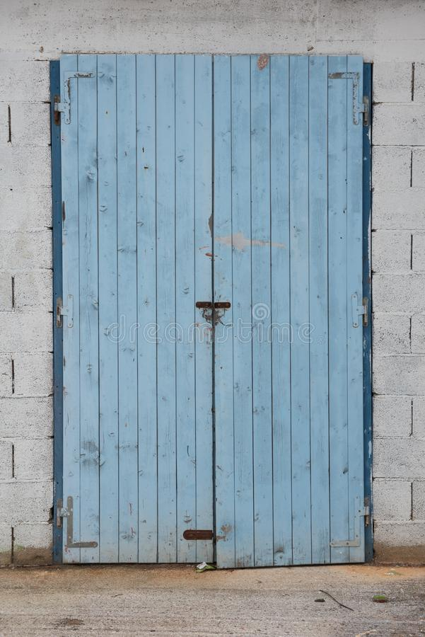Old blue wooden doors. Warehouse entrance royalty free stock photography