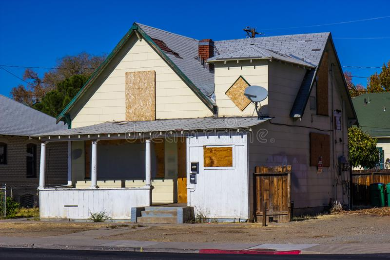 Old Boarded Up Home Lost To Foreclosure stock photos