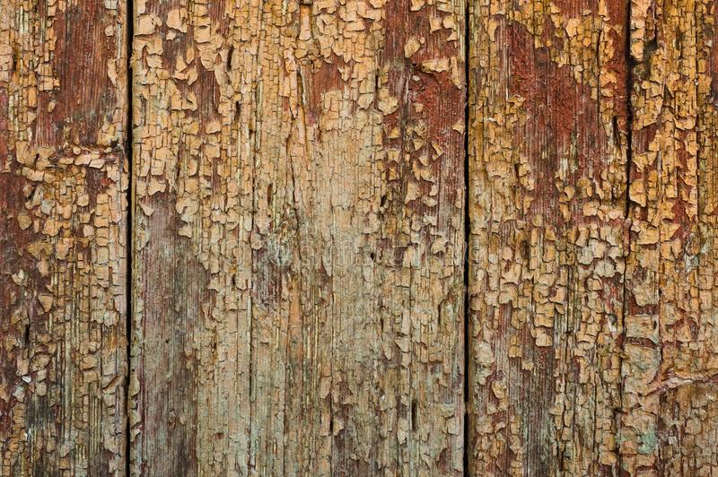 Old boards with cracked rusty paint. Textured wooden old background with vertical lines stock photo