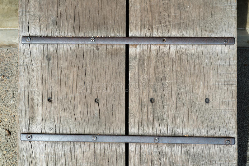 Old boards and metal rivets background. Old wood texture with metal rivets close up stock photos
