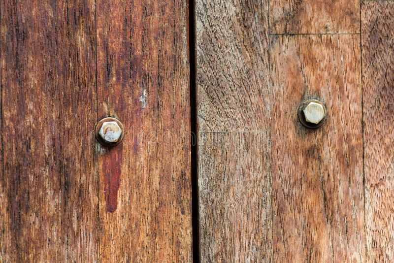 Old boards and metal rivets background. Old wood texture with metal rivets close up stock photography