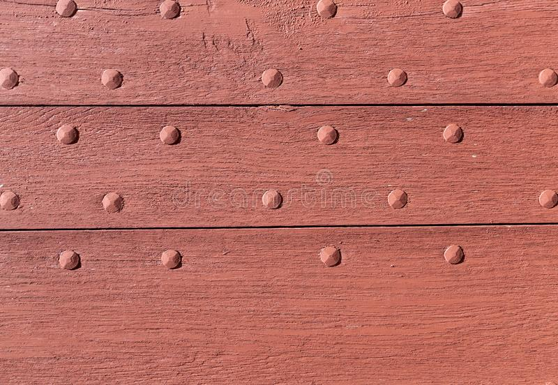 Old boards and metal rivets. Backgrounds and textures. Old boards and metal rivets. Backgrounds and textures royalty free stock photos