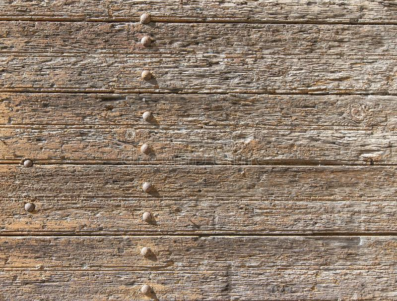 Old boards and metal rivets. Backgrounds and textures. Old boards and metal rivets. Backgrounds and textures stock photography