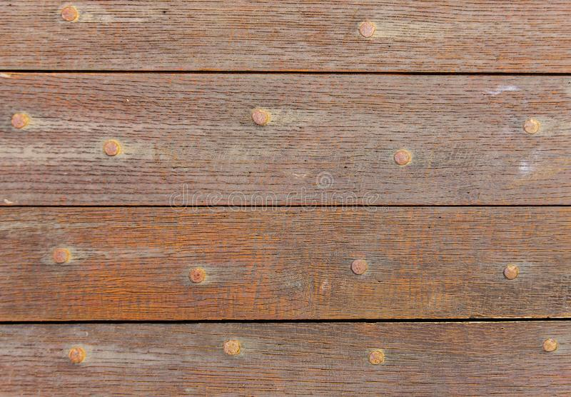 Old boards and metal rivets. Backgrounds and textures. Old boards and metal rivets. Backgrounds and textures stock photos