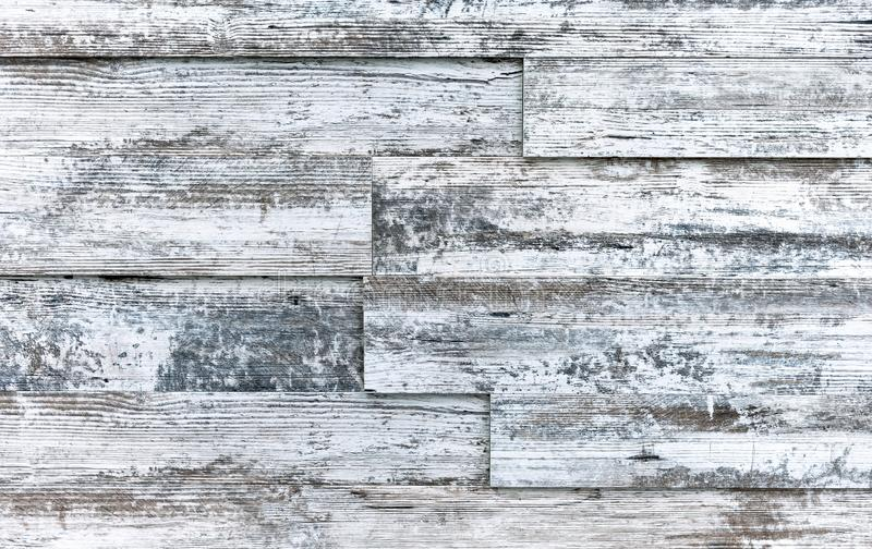Old boards with white paint. Background and texture of aged wood stock image