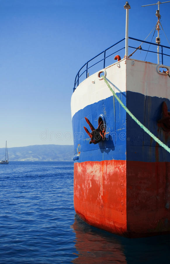 Old boat bow. View of a red and blue bow of an old boat moored in a Greek island stock photos