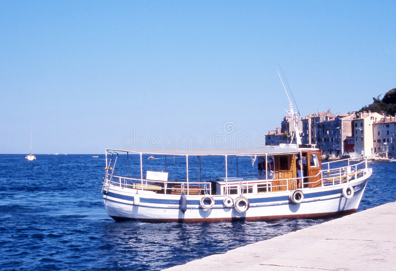 Old boat. Boat in the blue sea royalty free stock images