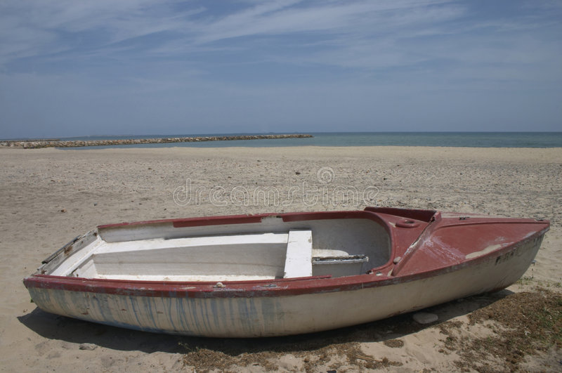 Old boat. In the beach royalty free stock photo