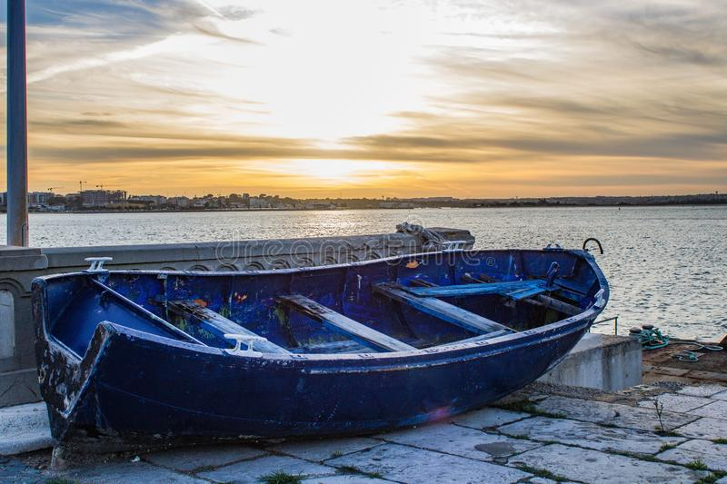 Old boat abandoned. In a dock in the city of Barreiro stock photo