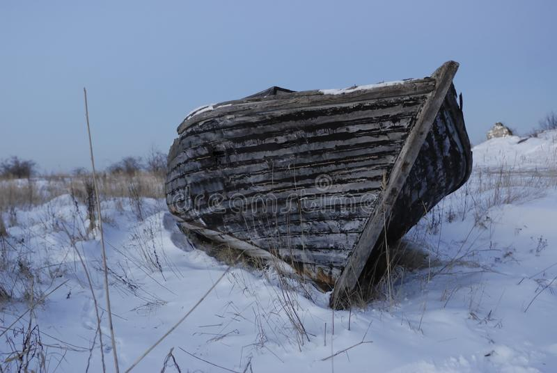 An old boat on the Baltic sea coast stock photography