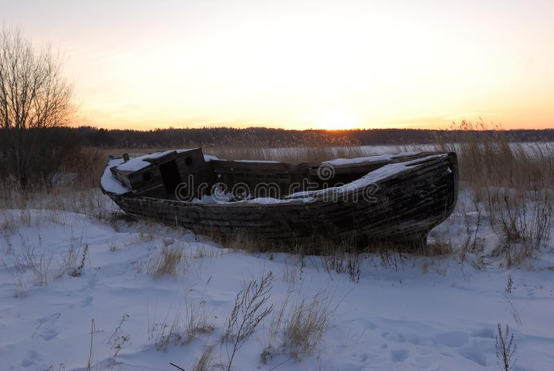 An old boat on the Baltic sea coast royalty free stock photo