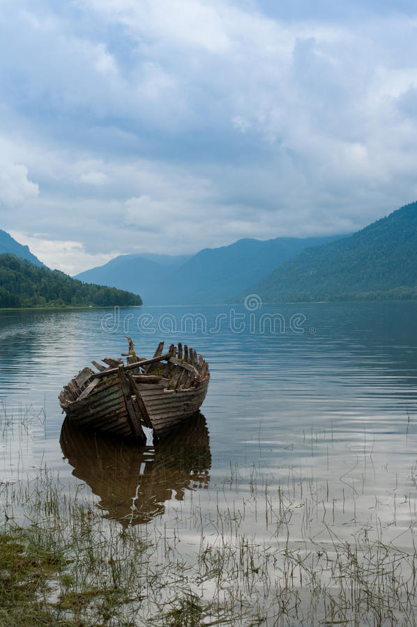 Old boat on the hazy lake stock images