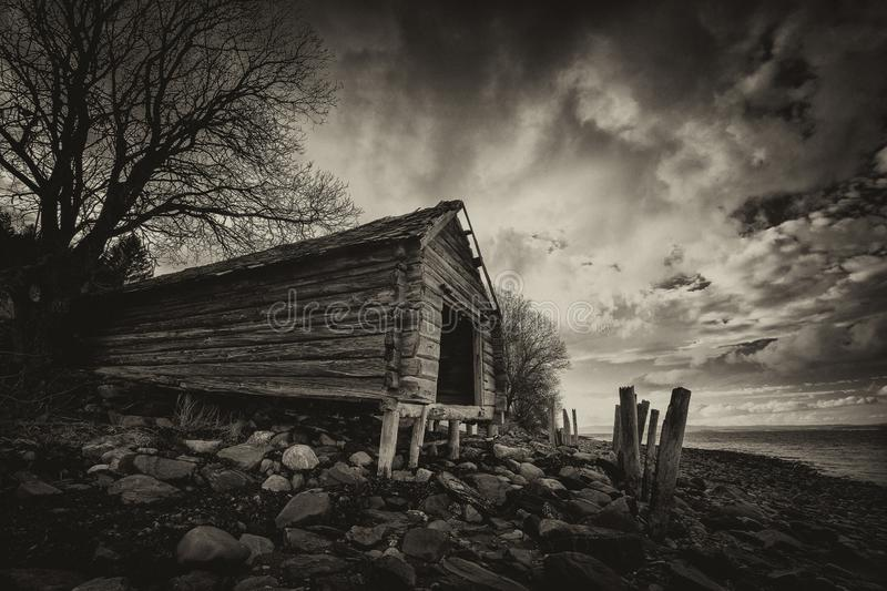 Old boat house on the shores of Trondheimsfjorden, Norway stock photography