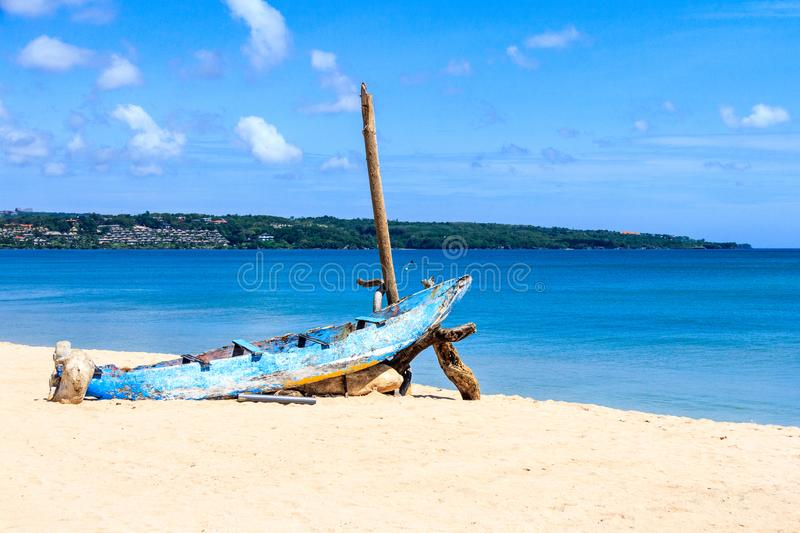 Old boat on Jimbaran beach. Bali, Indonesia royalty free stock image