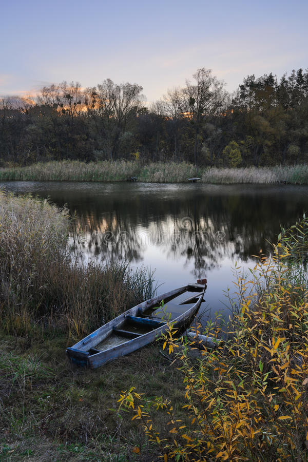 Old boat. Lonely old boat at dawn in the autumn royalty free stock image