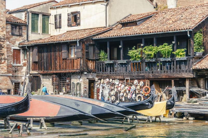 Old boat repair yard in Squero de San Trovaso. Gondola repair dock in Venice, Italy. Retro stylized photo royalty free stock image