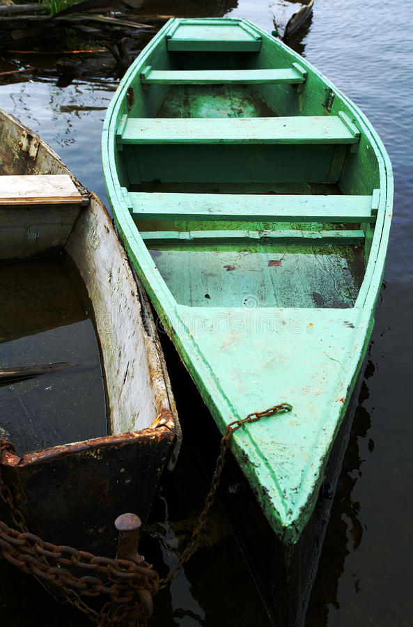 Old boat on a river stock photography