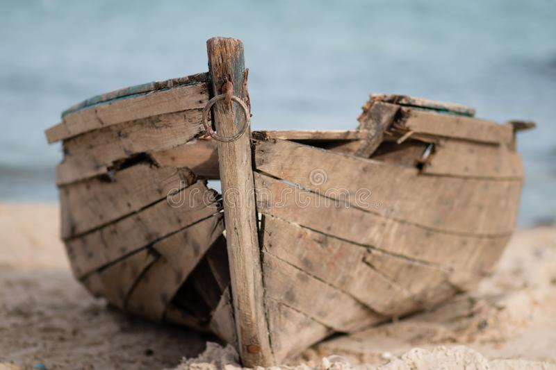 Old boat on sand royalty free stock photos