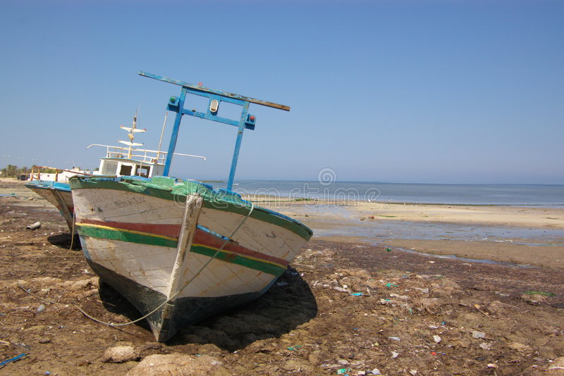 Download Old boat on sea shore stock photo. Image of coast, africa - 6561318