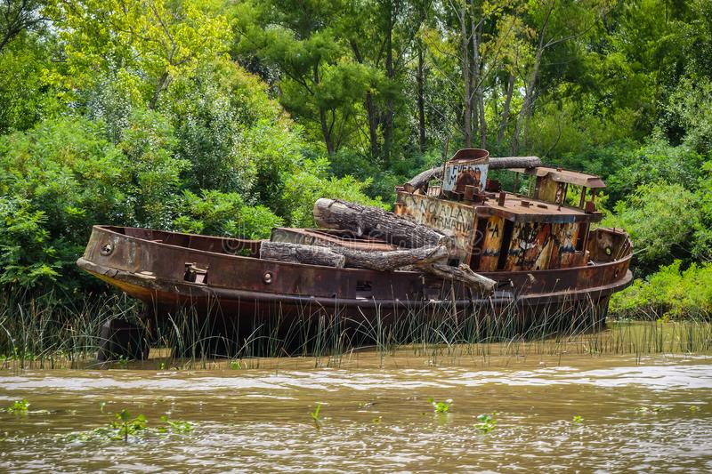 Old boat on the Tigre river Delta. Buenos Aires. Old rusty boat on the Tigre river Delta. Buenos Aires stock image