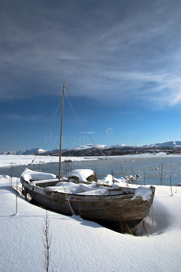 Old boat in winter royalty free stock images