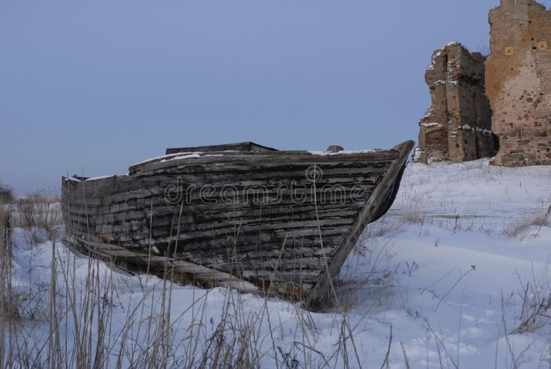 An old boat in winter royalty free stock images