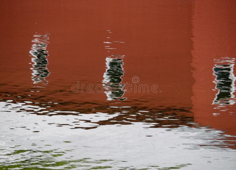 Reflections of the Old Boathouse. The old boathouse in Camden, Maine is reflected in the waters of the harbor royalty free stock photography