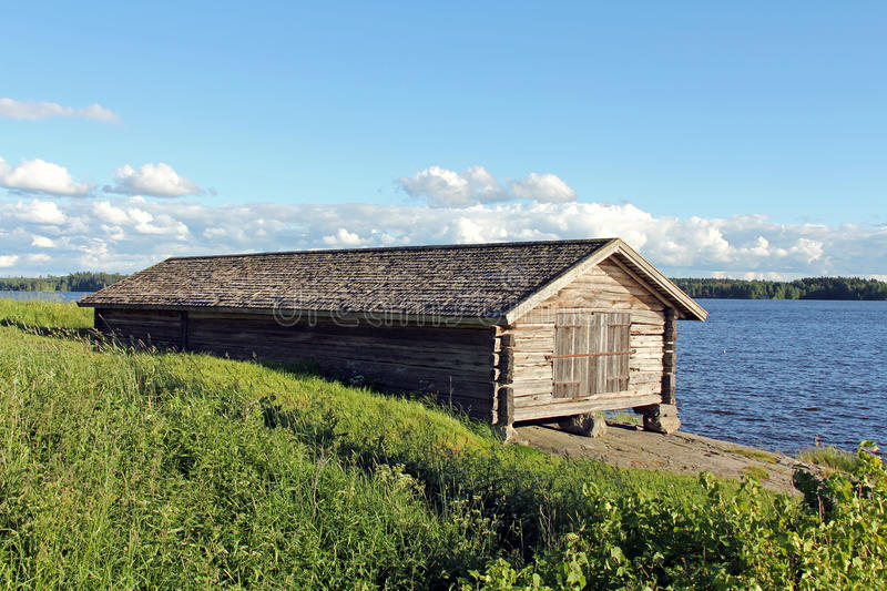 Old Boathouse by Lake stock photography