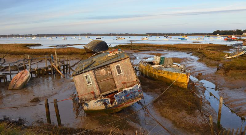 Old Boats on mud flats Felixstowe Ferry early evening stock photography
