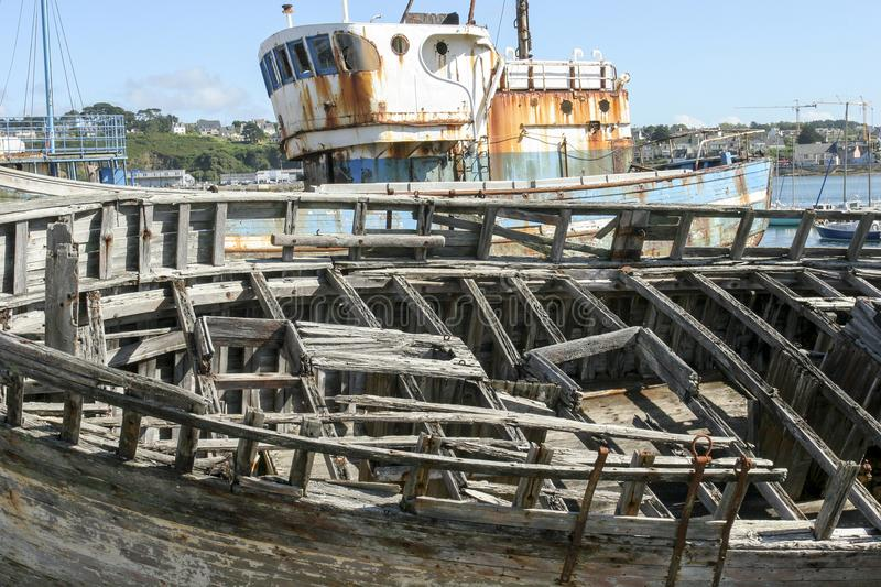 Old boats in ship graveyard in Brittany France. 07-25-2018 Camaret France. Old boats in ship graveyard in Brittany France stock image