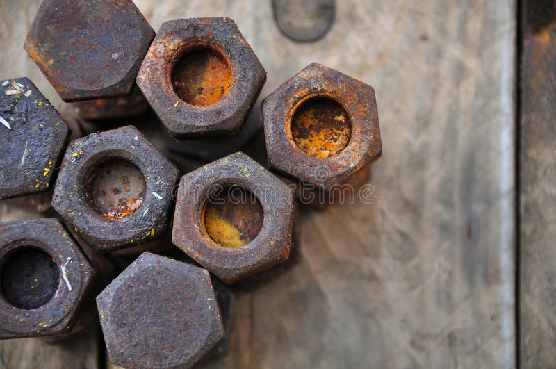 Old bolts or dirty bolts on wooden background, Machine equipment in industry work.  royalty free stock image