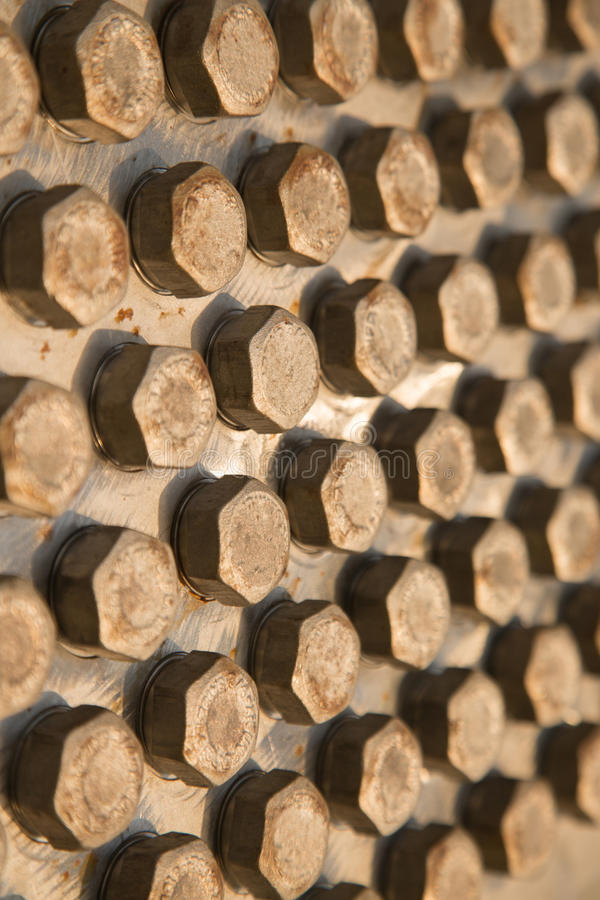 Old bolts or dirty bolts on wooden background, Machine equipment in industry work.  stock photos