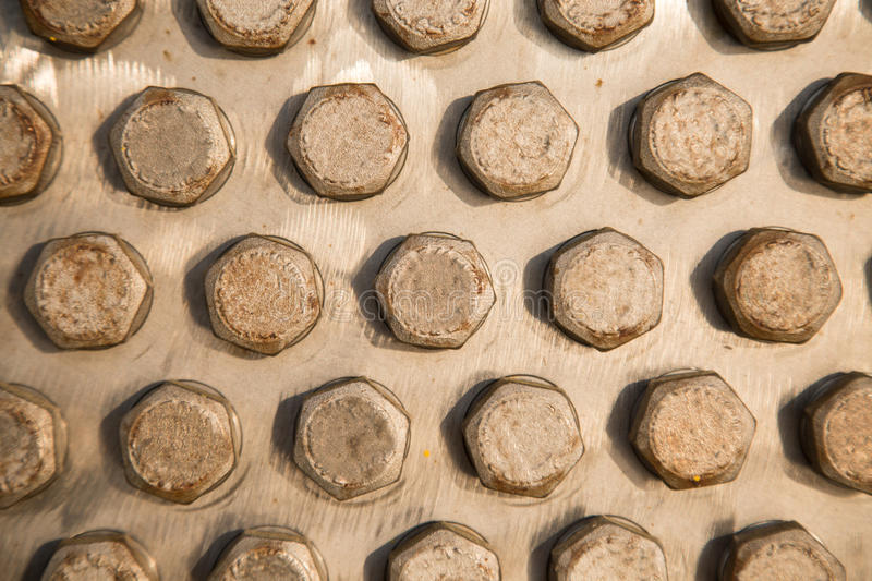 Old bolts or dirty bolts on wooden background, Machine equipment in industry work.  stock photography